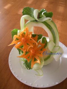 Pinwheel Flower Sqush Basket    This beautiful cut out pinwheel flowers are carve from carrot place on top of squash basket and garnish with celery ribbons.