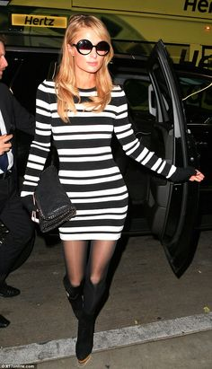 Pins on parade! Flaunting her lithe frame in a figure-hugging striped dress, Paris put her enviable curves on parade as she made her way into the packed airport