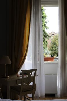 "DOUBLE CLASSIC ROOM: A view of the old churc in the private garden along ""Via Busdraghi."