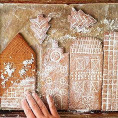 This Christmas, make a snowy cookie city of gingerbread houses. It's an easy Christmas decoration the kids can help make.