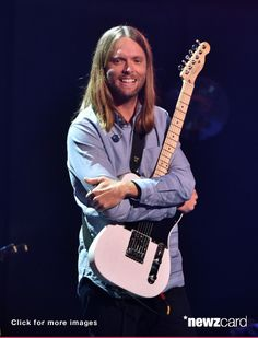 Musician James Valentine of Maroon 5 performs onstage druing the iHeartRadio Album Release Party with Maroon 5 LIVE on the CW at iHeartRadio Theater on August 26, 2014 in Burbank, California.  (Photo by Kevin Winter/Getty Images for Clear Channel)  --  Access, discover and share millions of images at *newzcard.com.