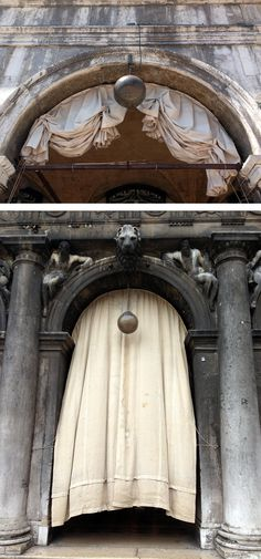 Arches with drapes all bunched at different levels surround Piazza San Marco, Venice.