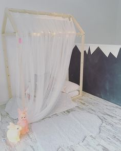 Lor Via Lima kids concept store, Roma / House shaped bed frame, chalkboard paint mountain wall