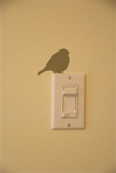 bird perched on your light switch...cute