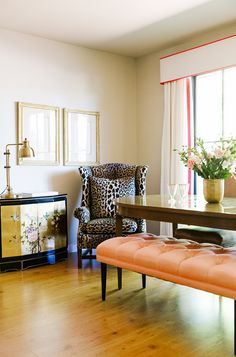 Leopard print armchair in bright dining room