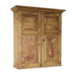 A Late 18th Century painted pine cupboard, with bold pediment above fielded panel doors enclosing a painted interior.  This cupboard has a wonderful patina and is the most fantastic colours.  There has been a repair to one side on the cornice where a section has been re attached.