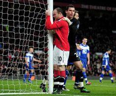 Wayne Rooney and Ben Foster