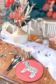 Check out this fun boho zoo-themed birthday party! The table settings are wonderful! See more party ideas and share yours at CatchMyParty.com