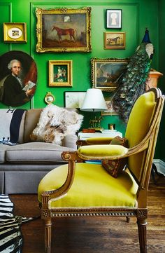 Another view of the same room. Mustard mohair chair in green living room with gallery wall of portraits and paintings. Decor, Room, Living Room Green, Interior, Home, Green Rooms, Decor Inspiration, Trending Decor, Green Living