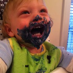 Blue icing goatee on this cute kid while eating birthday cake!