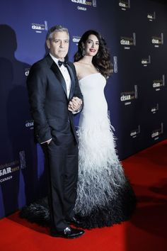 Amal Clooney, powerhouse human rights lawyer currently expecting twins, accompanied her actor husband George today at the César Film Awards Ceremony in Paris. They're essentially the French version of the Oscars, and George will be honored.     Getty    Advertisement – Continue...