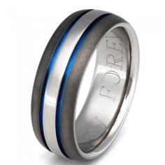 Get in touch with your winning personality within the extra bold style of this Sable Titanium ring, shown in 7mm width. Surrounded by sable finish edges, the brightly polished center of this domed profile ring gleams with a natural urge to celebrate. Two blue grooves set a festive mood and invite you to the party.