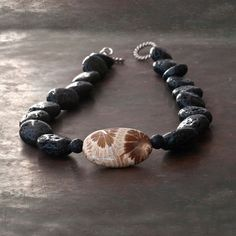 Black Lava and Fossil Agatized Coral Necklace by SunSanJewelry