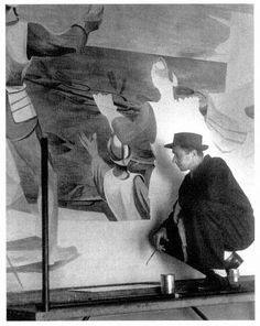 "Anton Refregier painting the mural, ""A History of California,"" a target of the Right in the 1950s, in the Rincon Annex Post Office (Labor Archives and Research Center, San Francisco State University)."