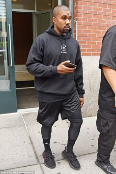 Kanye West wearing Yeezy Boost 350 Unreleased Colorway, New Balance Men's Performance Mesh Gym Shorts in Black, Adidas Traxion Premier Crew Socks and Kanye West Saint Pablo Tour Merchandise Hoodie