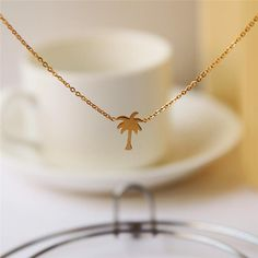 Fun and casual and cute Gold Palm Tree Pendant Necklace - The Happy Hummingbird - DYT Type 1 - light spring