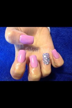 Pastel purple acrylic nails with rhinestone feature nail. Pretty diamond look! By Fakeit Nails :)