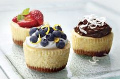 PHILADELPHIA Mini Cheesecakes 1 cup HONEY MAID Graham Cracker Crumbs 3/4 cup plus 2 Tbsp. sugar, divided 3 Tbsp. butter or margarine, melted 3 pkg. (8 oz. each) PHILADELPHIA Cream Cheese, softened 1 tsp. vanilla 3 eggs 1 cup whipping cream 2 cups blueberries 1 Tbsp. lemon zest #cupcakes #cupcakeideas #cupcakerecipes #food #yummy #sweet #delicious #cupcake