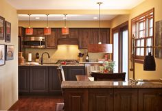 Transitional dining room and kitchen design by Creative Elegance Interiors.