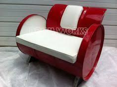 Padded steel back style 55 gallon steel drum arm chair with white vinyl upholstery and bright red powder coat finish.