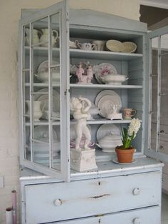 I want to distress this! I like the dark undertone to this hutch