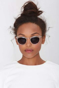 Get crystal clear in these cat-eye shades with clear cat-eye frames, silver hardware, gray lenses, and UV protection.