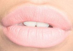 Light pink lips lined with white.