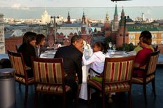 President Obama has dinner with his family on the roof of a hotel restaurant in Moscow, July 7, 2009.