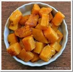 Chop 1 lb. butternut squash into 1 inch or half inch cubes  Place in bowl and add:  2 tablespoons olive oil    2 tablespoons balsamic vinegar    Arrange on baking sheet and sprinkle the top with:  parmesan cheese    salt    Bake at 400 degrees for 10-15 minutes, stirring once.