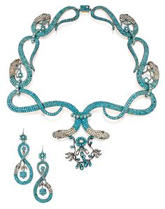 SILVER-GILT, TURQUOISE, SEED PEARL AND GARNET SNAKE NECKLACE AND EARRINGS Designed as a graduated series of coiled snake links set with cabochon turquoises and pearls suspending floral motifs, the eyes set with round garnets, length 16 inches; together with a pair of earrings of similar design; both pieces circa 1830.
