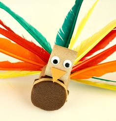 Turkey Fine Motor Activity and Craft Create a simple turkey fine motor activity for toddlers using an empty toilet paper roll and feathers. This could also be turned into a Thanksgiving craft. Thanksgiving Crafts For Toddlers, Fall Crafts, Thanksgiving Turkey, Fine Motor Activities For Kids, Craft Activities, Creative Activities, Creative Play, Turkey Craft, Preschool Crafts