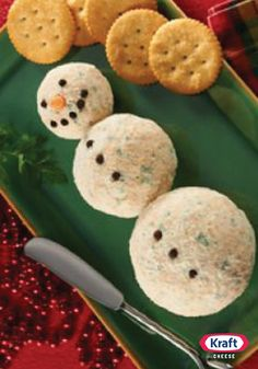Snowman Cheese Ball — No corncob pipe or coal required for this adorable Snowman Cheese Ball appetizer. But you will need a baby carrot, fresh chives and slivered almonds.