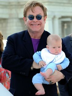 """Elton's Bundle of Joy  Elton John holds on tight to his little """"Rocket Man"""" -- 5-month-old Zachary. The Grammy winner and partner David Furnish took their baby boy on a boat ride on June 2 in Venice, Italy.    FILED UNDER:"""