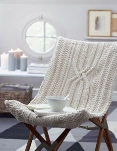 Cool 38 Soft And Comfy Knitted Furnishing Pieces For Fall And Winter : Cozy Knitted Furniture With White Wall Window Basket Candle And Fabric Chair Design