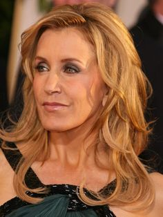 Felicity Huffman's long layers look stunning on the red carpet