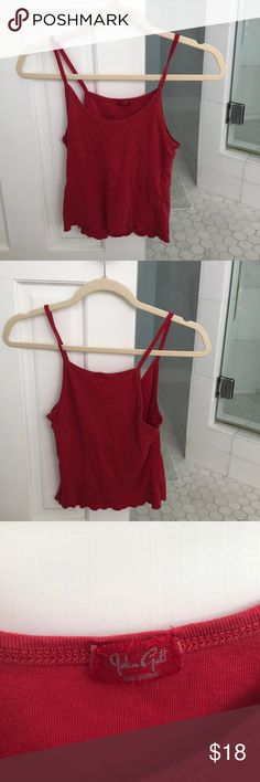 "Brandy Melville Red Tank Top The size from the company is ""one size fits all"" but tends to big girls with C cups and A cups. It is a cotton Red tank top, very soft and comfortable, only wore couple of times, spaghetti straps, not cropped. Nothing wrong with it just wasn't my style and was a little big on me (i am 104 pounds and am 5'6) Brandy Melville Tops Tank Tops"
