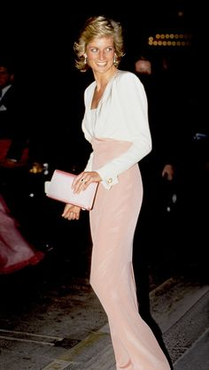 the slim, pink-and-white high-waisted Catherine Walker, her hair longer, her enjoyment evident, Diana's stardom