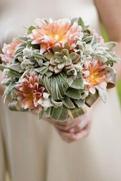 Love the use of succulents and lambs ear in this compact little bouquet! #bouquet