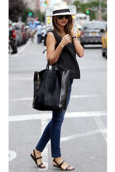 Miranda Kerr with the perfect casual look: black top, jeans with leopard spots, flat sandals, Panama hat and Céline bag by evangelina