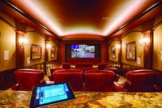 2013 Electronic House Home of the Year: The theater's 156-inch diagonal Stewart Filmscreen StudioTek 100 screen, Runco LS-10i projector and B 11.4-channel surround-sound system take movie viewing to a whole new level. On command from an iPad, the 156-inch screen ascends into the ceiling to reveal a 75-inch Samsung flat-panel TV. Meanwhile, the SmartView Video Tiling system from Savant lets them view nine high-def video sources at once, all on the same screen.