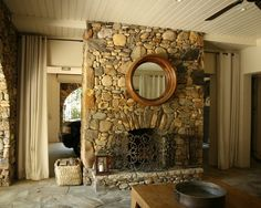 Refreshing Home Design in Earth Color Theme: Rustic Living Room Stone Fireplace Round Mirror House In Atlanta ~ gozetta.com Decoration Inspiration