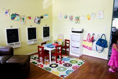 I'm going to hang frame photos like this and make it look like they're pinned on a clothes line! Yay for play room!