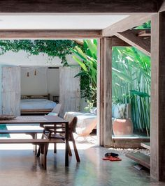 Stunning .. bringing the outside in and vice versa .. do not underestimate the power of plants !  Elle Decoration UK