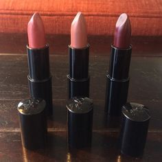 Lancôme new lipstick bundle burgundy, mauve, bloom Three new unused cream and sheen lipsticks from Lancôme. Sample size. Colors are pretty burgundy (cream), trendy mauve (cream), designer bloom (sheen). The trendy mauve tube stick was lightly pressed on cover so shows tiny imprint. Lancome Makeup Lipstick