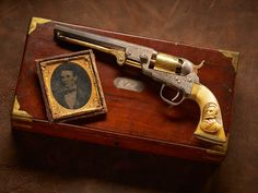 Abraham Lincoln Colt Pocket Revolver – The Model 1849 Pocket revolver was the most popular cap-and-ball revolver Colt ever made. Almost 340,000 of them were manufactured over a 23-year period in the 19th century. This particular example honors President Abraham Lincoln. Featuring a gold trigger, cylinder, and loading lever, it is also heavily engraved. The ivory stocks, now colored with age, have a wonderful carved bust of Lincoln on the left panel.
