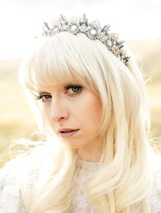 silver bridal crown by AMAROQ. And her dreamy makeup? It was done by Aurora Lady.