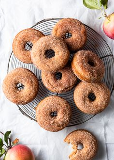 Homemade baked apple donuts recipe, coated with cinnamon sugar topping. Tender egg free cake donuts are bursting with flavor from applesauce, olive oil, vanilla, and pie spice. Quick and easy fall. Apple Donut Recipe, Easy Donut Recipe, Baked Donut Recipes, Apple Recipes, Baked Cider Donuts Recipe, Cookie Recipes, Cinnamon Sugar Apples, Cinnamon Sugar Donuts, Apple Cinnamon