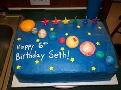 Seth's Solar System - My son is crazy about anything dealing with outer space.  So he wanted all the planets on his 6th birthday cake.  I searched all over the internet and our local library and couldn't find anything he'd like.  So he and I got a box of fondant and went wild!  He heloed make all the planets and the sun.  The stars are candy that I found in a local dollar store and just picked out the yellow ones.  The inside is Duncan Hines yellow with white chocolate mousse.  The frosting…
