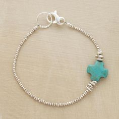 """SOUL CROSS BRACELET--The simplest cross carved in sky blue turquoise is a talisman of peace on our bracelet of tiny faceted silver beads. Sterling lobster clasp. Made in USA. Exclusive. Approx. 7-1/2""""L."""