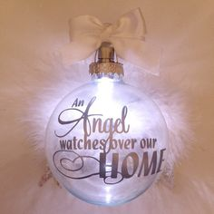 Light up twist LED light memorial ornament with angel wings.